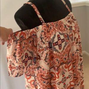 Off the shoulder dress with adjustable straps.